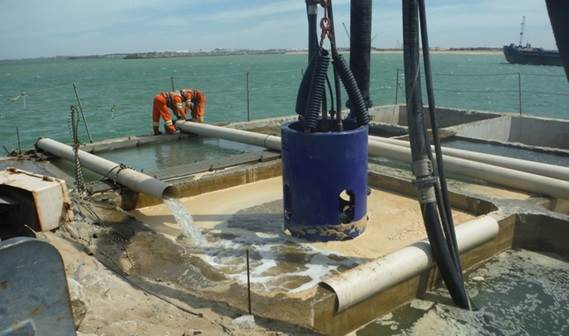 Damen DOP submersible dredge pump emptying concrete caissons in Brazil
