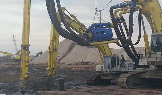 Submersible dredge pump mounted to excavator for environmental clean up
