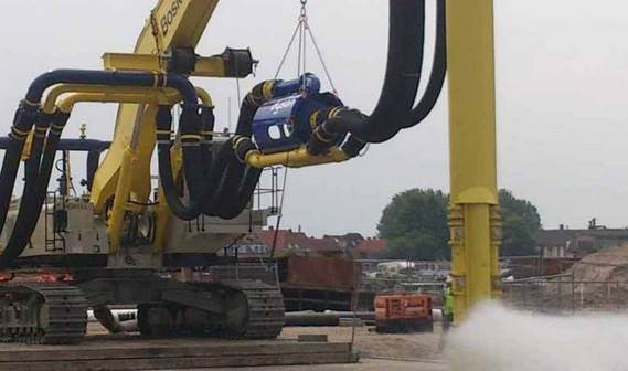 Submersible dredge pump skid excavator mounted