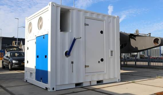 The 10 ft container houses the frequency drive and the controls