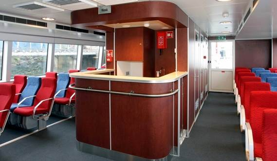 Air-conditioned passenger saloon with economy and business class seats, bar and toilets.