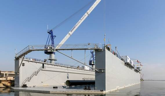 The drydock can be equipped with cranes with sufficient reach to carry equipment and materials from drydock to ship and vice versa.