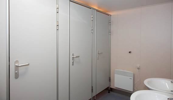 Changing room with lockers, showers and toilets.