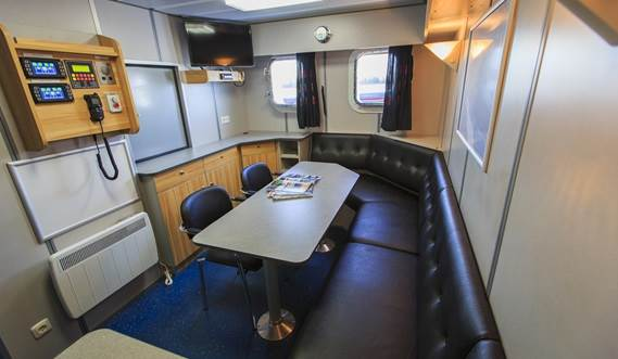 Modern, spacious, air-conditioned cabins, above waterline, with writing table, drawers, lockers and book racks.