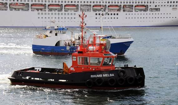 The 'Rhumb Melba', a Damen Stan 1606 Tug, escorts the fishing boat 'Challenge' in Sydney harbour.