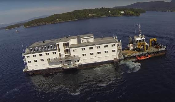 Damen Multi Cat 2712 'FOX FIGHTER' towing floating hotel in Norway