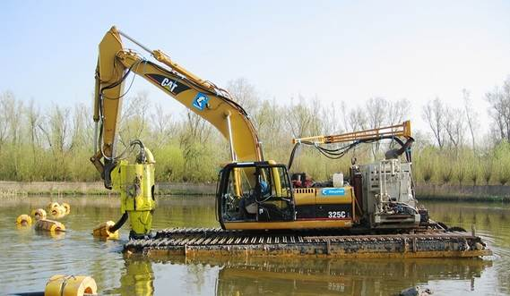 DOP200 on amhibious excavator cleaning a pond