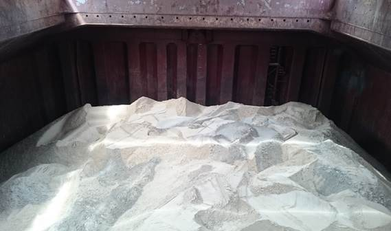 The cargo hold of the bulk carrier loaded with sand