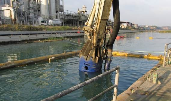 The DOP attached to the crane boom with its floating pipe line in the background